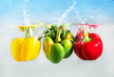 The colorful capsicum or bellpepper in the water photo