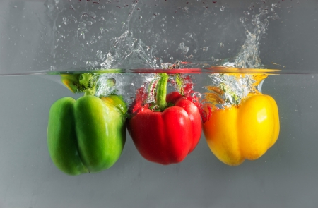 The colorful capsicum or bellpepper in the water