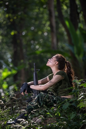 Special force with the gun in the jungle photo