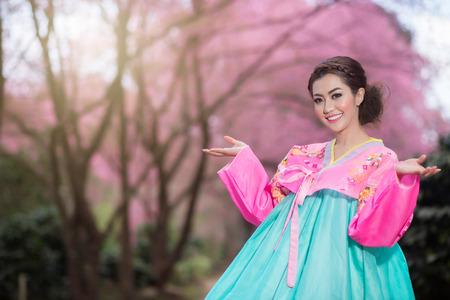hanbok: Hanbok: the traditional Korean dress and beautiful Asian girl with sakura