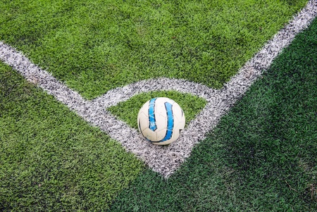 futsal: Cornor kick of football on green field