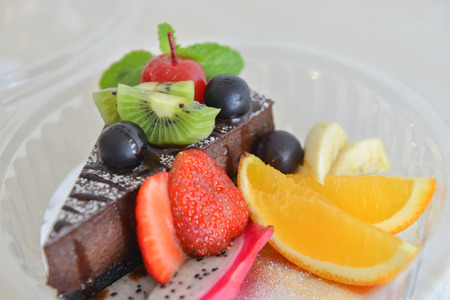 Chocolate moose cake with fruits photo