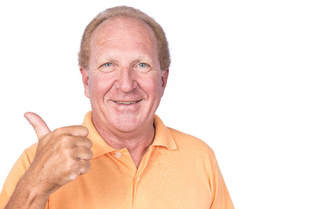 Handsome old man in orange polo-shirt shows thumb up photo