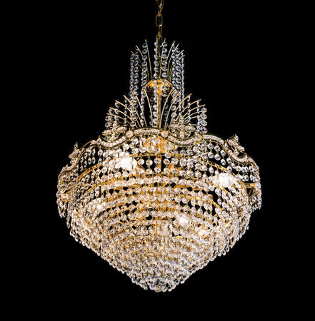 beautiful crystal chandelier in a room on black background photo