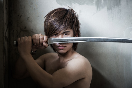 Asian man with sword of justice