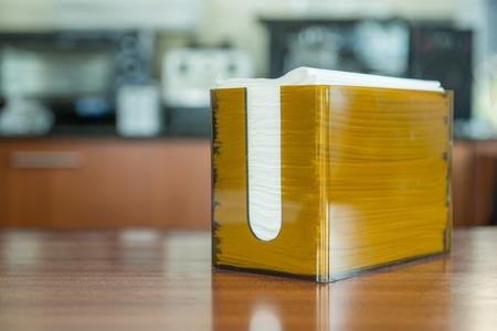 Orange box with napkin in coffee shop photo
