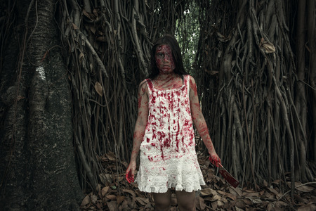 suicidal: Suicidal girl in forest Stock Photo