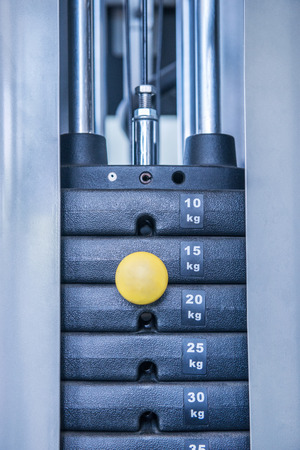 weight machine: gym weight machine. Amount of weight on lifting machine