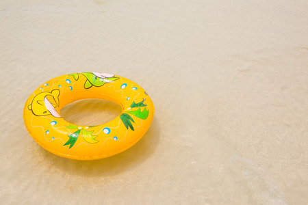 grand strand: orange pool float, pool ring on the beach Stock Photo