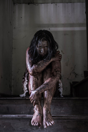 dreadful: Zombie girl in haunted house Stock Photo