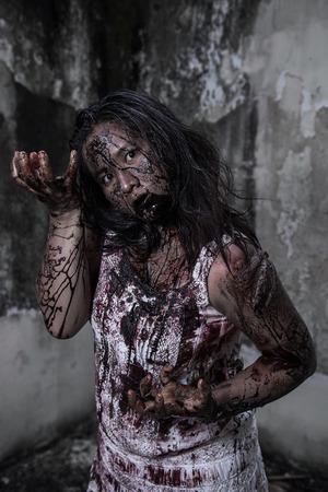 haunt: Zombie girl in haunted house Stock Photo