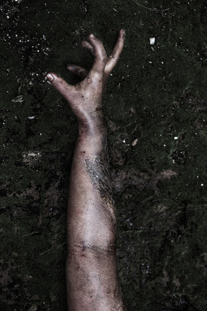 Hand of Zombie girl in haunted house photo