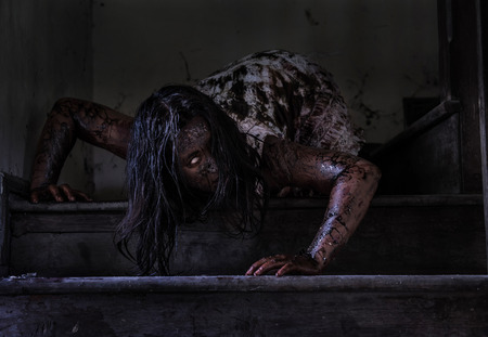 Zombie girl in haunted house Stock Photo