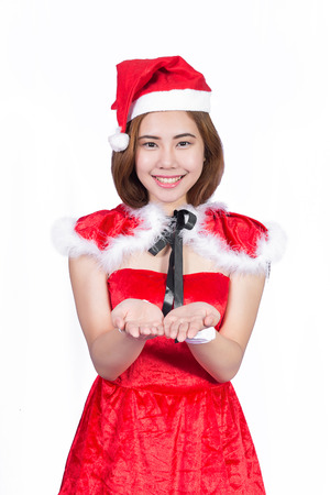 Pretty Asian girl in Santa costume for Christmas on white background photo