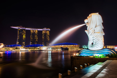 SINGAPORE-SEP 04: The Merlion fountain and downtown on Sep. 04, 2014. Merlion is an imaginary creature with a head of a lion and the body of a fish and  symbol of Singapore.