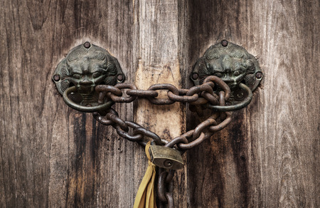 keep gate closed: old rusted lock on a door