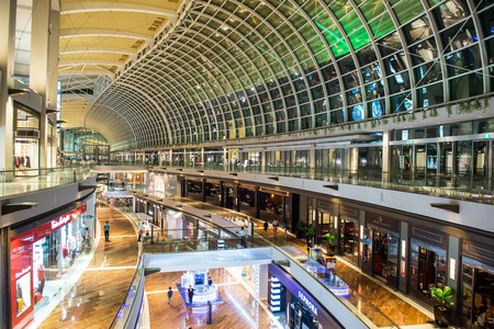 SINGAPORE - OCT, 27 2014: Shopping mall at Marina Bay Sands Resort in Singapore. It is billed as the worlds most expensive standalone casino property at S$8 billion