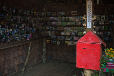 red mail box and postcard photo
