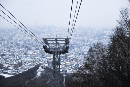 sapporo: Rope-way on the mountain with sapporo city background Stock Photo