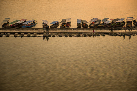 sangkhla buri: Sangkhla Buri, Thailand-Feb 14: Local people and tourists on the longest wooden bridge in western region of Thailand on February 14, 2015 in Sangkhla Buri, Thailand.