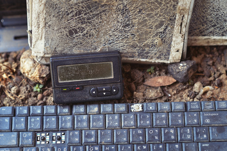 An old broken pager and keyboard Stock Photo
