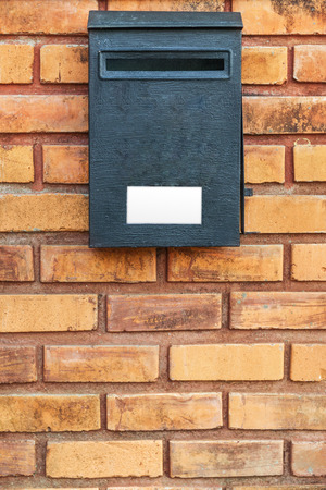 pillar box: Wood post box on brick wall Stock Photo