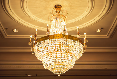crystal chandelier: beautiful crystal chandelier in ball room Stock Photo