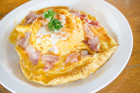 scrambled omlette eggs with bacon on rice Stock Photo