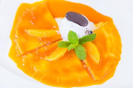 Orange crepe cake with ice cream photo