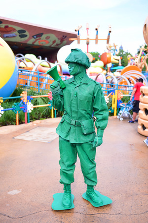 toy story: HONG KONG, CHINA - JUN 10: Green Animation Soldier in Toy Story in Disneyland on June 10, 2015. Hong Kong Disneyland Built in 2012,Is the worlds five Disneyland Editorial