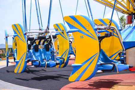 thrill: OCEAN PARK, HONGKONG - JUNE 11: The wondeful Anusement park in Hong Kong. Whirly Bird in Thrill mountain Zone on JUNE 11, 2015.