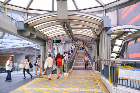 longest: HONG KONG - JUN 12: Pedestrian overpass downtown or Central–Mid-Levels escalator in Central District of Hong Kong on JUNE 12, 2015. it is the longest outdoor escalator in the world.
