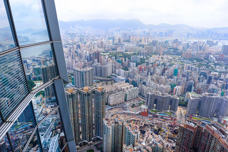 HONG KONG, CHINA - JUN 12: Panorama view to Hong Kong from Sky100 on JUNE 12, 2015, Hong Kong, China. Sky100 is a observation deck on the 100th floor of the International Commerce Centre