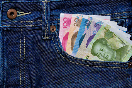 rmb: Yuan or RMB in Jeans pocket, Chinese Currency