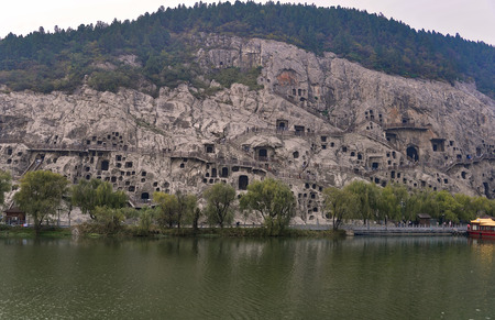 notable: Luoyang,China - OCT 23:  Longmen grottoes on October 23, 2015.It is one of the four notable grottoes in Luoyang,Henan,China . UNESCO World Heritage Site.