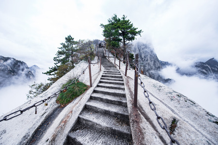 Huashan mountain. The highest of China's five sacred mountains, called the West Mountain,well known for steep trails, breath-taking cliffs, narrow passages, and grand scenery