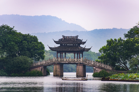 a very famous pavilion bridge-yu dai qiao (jade belt) - in west lake, hangzhou, china was built in song dynasty and rebuilt in qing dynasty Stock Photo