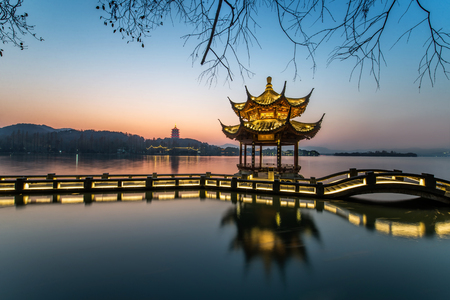 beautiful hangzhou in sunset and ancient pavilion