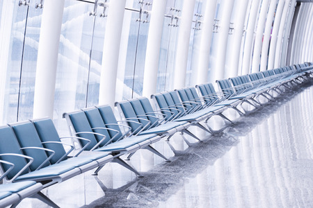 row of green chair at airport