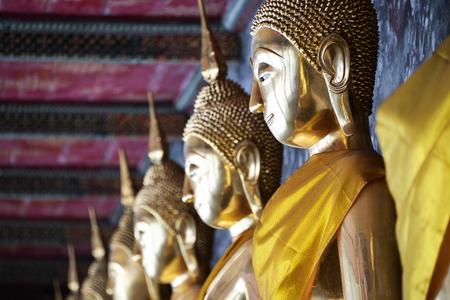 buddha image: The row of golden buddha image in sitting attitude Stock Photo