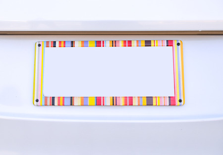 license plate: number plate of car with rainbow color frame Stock Photo