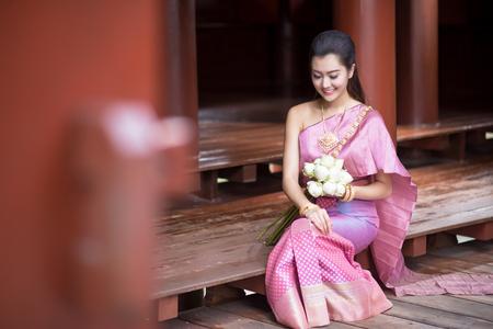 enchantress: Thai girl dresses Thai traditional costume at traditional Thai house