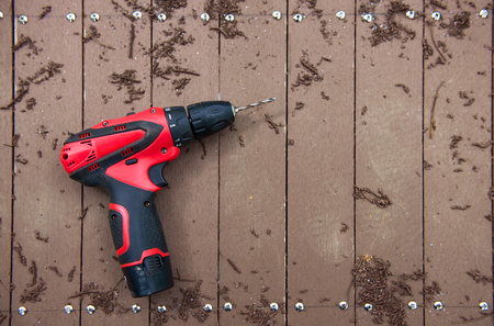 drill floor: electric drill on wooden floor Stock Photo