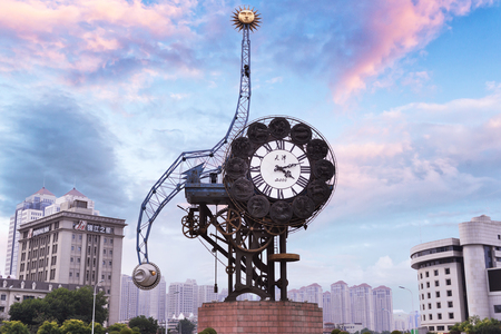 represents: Tianjin, China - JULY 04, 2016: Cityscape of Century clock stands 40-meters high and weighs 170-tons, it represents the beginning of the Chinese Modern Industry in Tianjin.