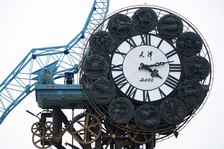 Tianjin, China - JULY 04, 2016: Cityscape of Century clock stands 40-meters high and weighs 170-tons, it represents the beginning of the Chinese Modern Industry in Tianjin.