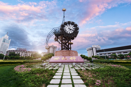 weighs: Tianjin, China - JULY 04, 2016: Cityscape of Century clock stands 40-meters high and weighs 170-tons, it represents the beginning of the Chinese Modern Industry in Tianjin.