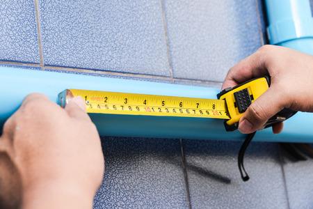 mesure: Worker use measuring tape mesure PVC pipe.