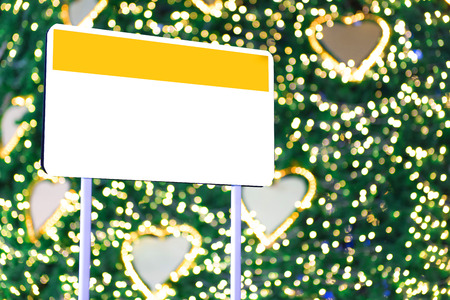 Empty sign and Christmas light blur background