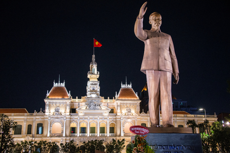 center hall colonial: Ho Chi Minh City, Vietnam- DEC 10, 2016. The former city hall of Saigon was built during the French colonial period.Today it houses government offices. A statue of Ho Chi Minh stands in front.