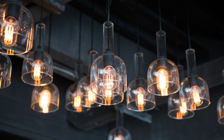 Arrangement of hanging lighting, lightbulb Editorial